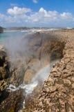 Playa Canoa waves and rainbow Stock Image