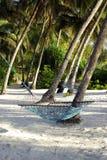 Playa celeste con la hamaca Imágenes de archivo libres de regalías