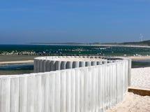 Playa con la cerca de madera blanca Imágenes de archivo libres de regalías