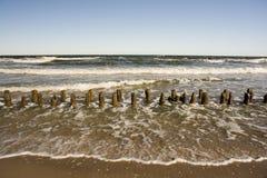 Playa con las barreras Imágenes de archivo libres de regalías