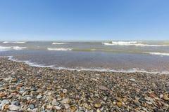 Playa cubierta en guijarros - Ontario, Canadá del lago Hurón Imágenes de archivo libres de regalías