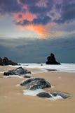 Playa de Adraga en la puesta del sol Imagen de archivo