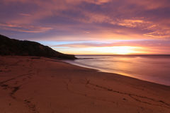 Playa de Belces en la salida del sol Fotos de archivo