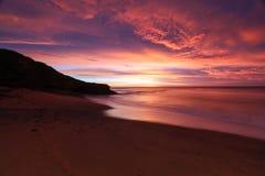 Playa de Belces en la salida del sol Foto de archivo libre de regalías