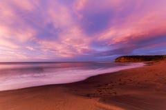 Playa de Belces en la salida del sol Foto de archivo