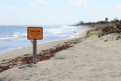 Muestra de la precaución en la playa de Dania Imágenes de archivo libres de regalías