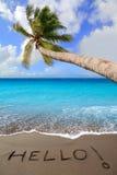 Playa de la arena de Brown con palabra escrita hola Fotografía de archivo libre de regalías