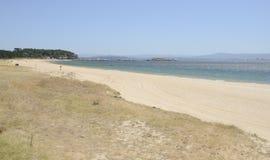 Playa de la arena de la multa de Galicia Imagenes de archivo