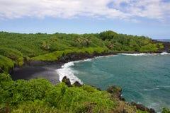 Playa de la arena del negro de Waianapanapa Imagen de archivo