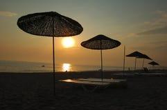 Playa de la puesta del sol Imagen de archivo libre de regalías