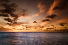Playa de la puesta del sol Fotos de archivo libres de regalías