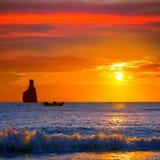 Playa de la puesta del sol de Ibiza Cala Benirras en San Juan en balear Foto de archivo libre de regalías