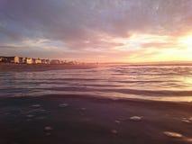 Playa de la puesta del sol de la casa de playa Imágenes de archivo libres de regalías