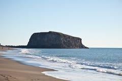 Playa de la roca de la cabra Imagenes de archivo
