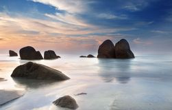 Playa de la salida del sol fotografía de archivo libre de regalías