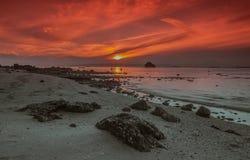 Playa de la salida del sol Imagen de archivo libre de regalías