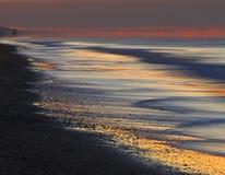 Playa de la salida del sol Imágenes de archivo libres de regalías