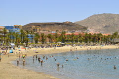 Playa De Las Americas beach tourists on the beach enjoying the s Royalty Free Stock Photo