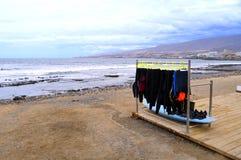 Playa De Las Americas surfing wetsuits Royalty Free Stock Photos