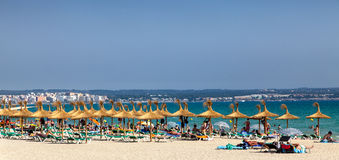Playa de Palma. Spain,July 7, 2012: Image of people relaxing in a sunny summer day on  beach in Mallorca,Spain. Playa de Palam is a 6 km beach located close to Stock Image