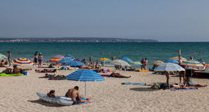 Playa de Palma. Spain,July 7, 2012: Image of people relaxing in a sunny summer day on  beach in Mallorca,Spain.  is a 6 km beach located close to the capital Stock Image