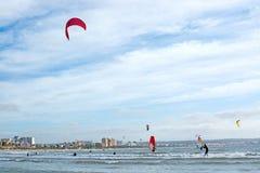 Kitesurfing Playa de Palma. PLAYA DE PALMA, MALLORCA, SPAIN - DECEMBER 14, 2017: Kitesurfing on the winter beach on a windy day on December 14, 2017 in Mallorca Royalty Free Stock Photos