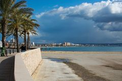 Playa de Palma winter beach. PLAYA DE PALMA, MALLORCA, SPAIN - DECEMBER 16, 2017: Playa de Palma winter beach on a sunny day on December 16, 2017 in Mallorca Stock Image