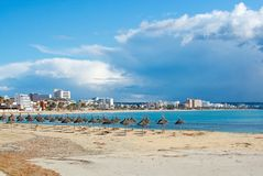 Playa de Palma winter beach. PLAYA DE PALMA, MALLORCA, SPAIN - DECEMBER 16, 2017: Playa de Palma winter beach on a sunny day on December 16, 2017 in Mallorca Stock Photography