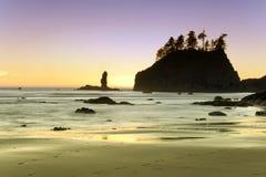 Playa de rubíes en la puesta del sol Imágenes de archivo libres de regalías