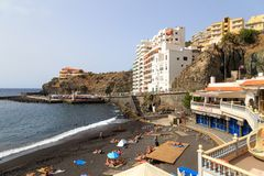Playa de San Marcos. Near Icod de los Vinos on Tenerife island, Canaries, Spain, with black sand beach and hotels royalty free stock image