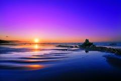 Playa de Sopelana en la puesta del sol Foto de archivo libre de regalías