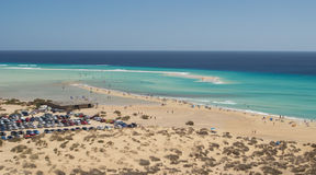 Playa de Sotavento, overview. Fuerteventura, Playa De Sotavento on Jandia peninsula. Kite surf, surf and fun on the gorgeous beach. Panoramic and aerial view royalty free stock photos