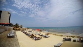 Playa del Carmen Beach time lapse. People relaxing and tanning at the Beach and Caribbean sea in a resort in Playa del Carmen in the Yucatan Peninsula Mexico stock video