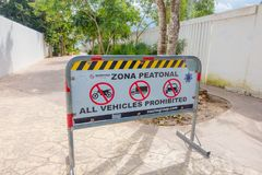 Playa del Carmen, Mexico - January 10, 2018: Informative sign of all vehicles prohibited in a small area close to the. Beach. The city boasts a wide array of Royalty Free Stock Photo