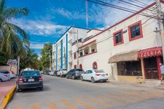 Playa del Carmen, Mexico - January 10, 2018: Outdoor view of some cars parked on 5th Avenue, the main street of the city. The city boasts a wide array of stock photo