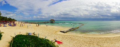 Playa del Carmen, Mexico - January 10, 2018: Panoramic view of unidentified people on the beach swimming and sunbathing. In Playa del Carmen at sunset Stock Photos