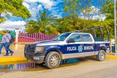 Playa del Carmen, Mexico - January 10, 2018: View of a blue police van parked at outdoors in 5th Avenue, the main street. Of the city. The city boasts a wide stock images