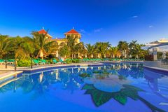 Luxury swimming pool scenery in Mexico. PLAYA DEL CARMEN, MEXICO - JULY 11, 2011: Scenery of luxury swimming pool at RIU Palace Hotel in Playa del Carmen, Mexico Stock Image