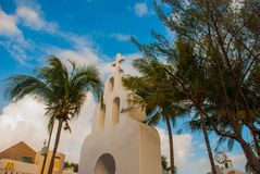 PLAYA DEL CARMEN, MEXICO, Riviera May: The Catholic Church on the background of palm trees.  royalty free stock photography