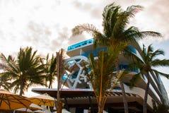 Playa del Carmen, Mexico, Riviera Maya: Facades of hotels and coconut palms stock photography