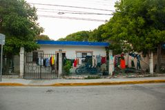 Playa del Carmen, Mexico, Riviera Maya: The usual Mexican house, on the ropes dried linen.  royalty free stock photography