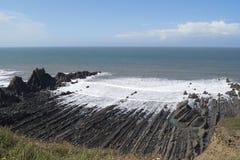 Playa del corte de la onda en Devon del norte Imagen de archivo
