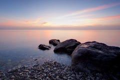 Playa del invierno por la tarde Imagen de archivo libre de regalías