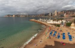 Playa del Mal Pas beach in Benidorm. Editorial Benidorm, Spain - October 8, 2017: Holiday makers on the smallest beach in Benidorm, Mal Pas Beach, on the eastern Stock Photography