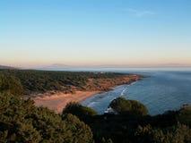 Playa del ` s de Cañuelo en la puesta del sol Foto de archivo
