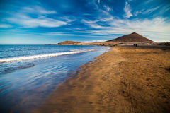 Playa el Medano beach. View of Playa el Medano beach with Montana Roja mountain on the background, Tenerife, Canary islands, Spain Stock Image