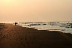 Playa en la puesta del sol Fotografía de archivo