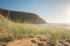 Playa en la salida del sol Foto de archivo libre de regalías