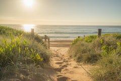 Playa en la salida del sol Imagen de archivo libre de regalías