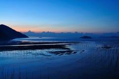 Playa en madrugada Foto de archivo libre de regalías